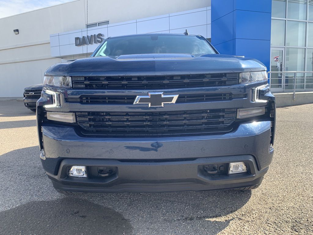 Blue 2021 Chevrolet Silverado 1500 Left Front Head Light / Bumper and Grill in Brooks AB
