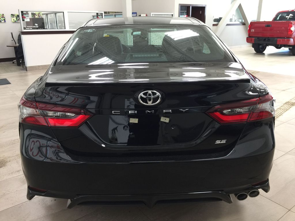 Black[Midnight Black Metallic] 2021 Toyota Camry SE FWD Rear of Vehicle Photo in Sherwood Park AB