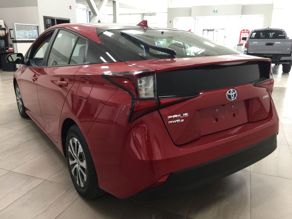 Red[Supersonic Red] 2021 Toyota Prius Technology Advanced AWD-e Left Rear Corner Photo in Sherwood Park AB