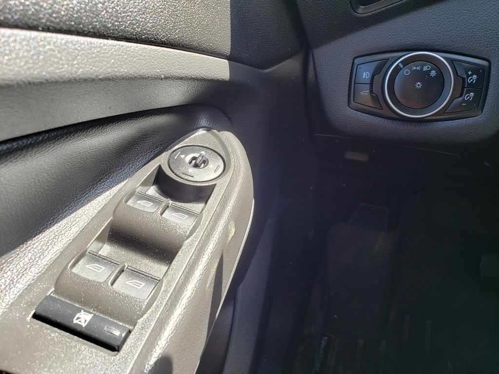 Silver[Ingot Silver] 2017 Ford Escape Left Front Interior Door Panel Photo in Kelowna BC