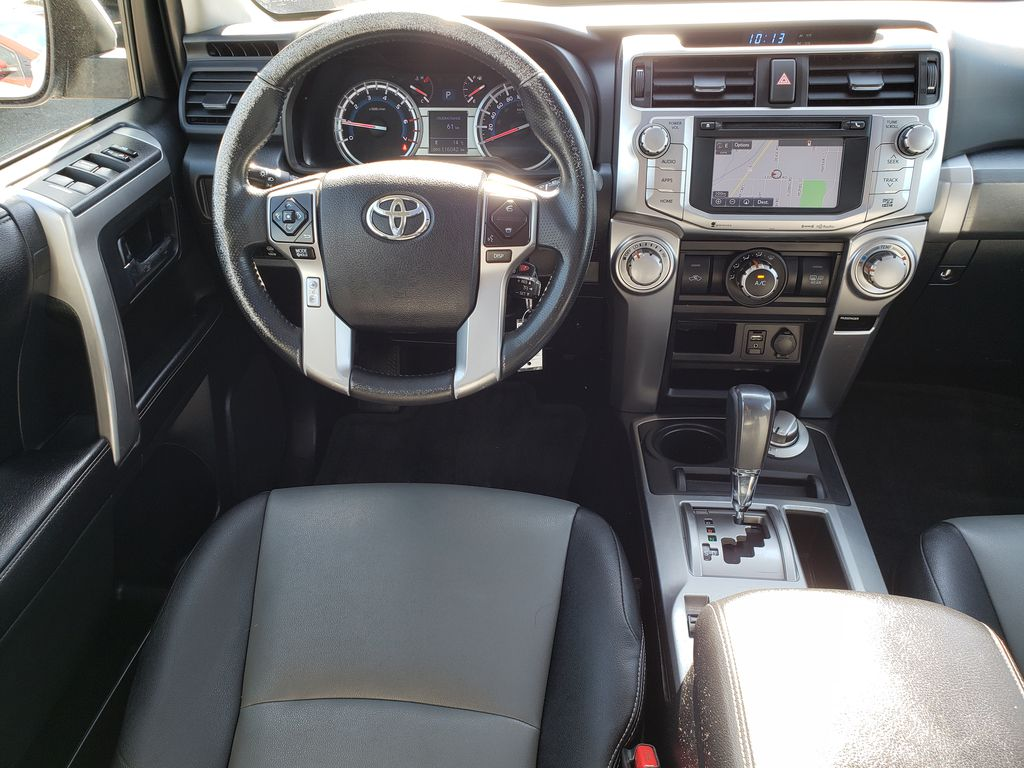 Silver[Classic Silver Metallic] 2016 Toyota 4Runner Steering Wheel and Dash Photo in Kelowna BC