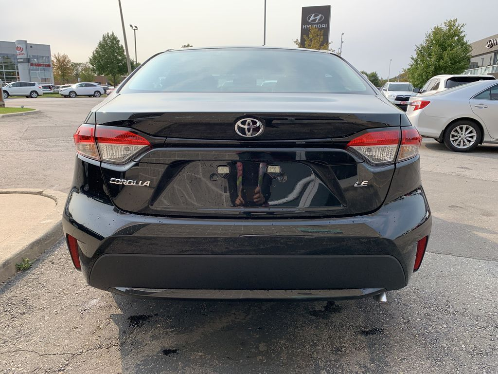Black[Black Sand Pearl] 2021 Toyota Corolla LE Upgrade Package BPRBLC BM Left Front Interior Photo in Brampton ON