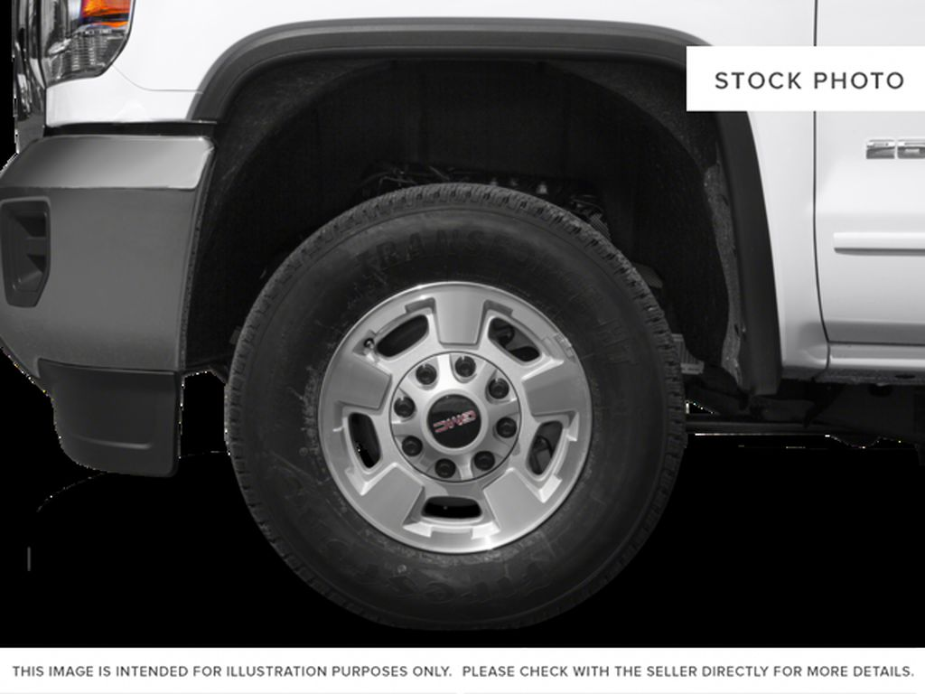 White[Summit White] 2015 GMC Sierra 2500HD Left Front Rim and Tire Photo in Fort Macleod AB