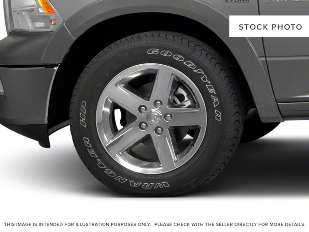 Green[Hunter Green Pearl] 2011 Ram 1500 Left Front Rim and Tire Photo in Fort Macleod AB