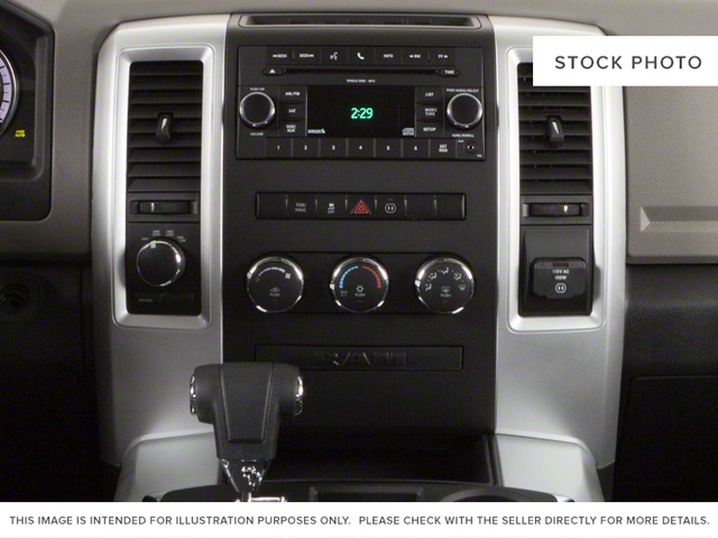 Green[Hunter Green Pearl] 2011 Ram 1500 Center Console Photo in Fort Macleod AB