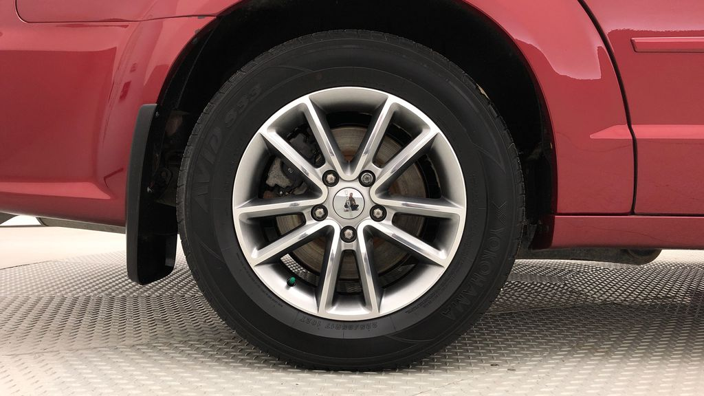 Red[Deep Cherry Red Crystal Pearl] 2015 Dodge Grand Caravan SXT Premium Plus - Leather, Rear DVD Right Rear Rim and Tire Photo in Winnipeg MB