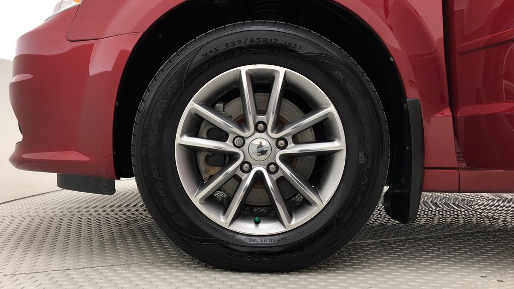 Red[Deep Cherry Red Crystal Pearl] 2015 Dodge Grand Caravan SXT Premium Plus - Leather, Rear DVD Left Front Rim and Tire Photo in Winnipeg MB