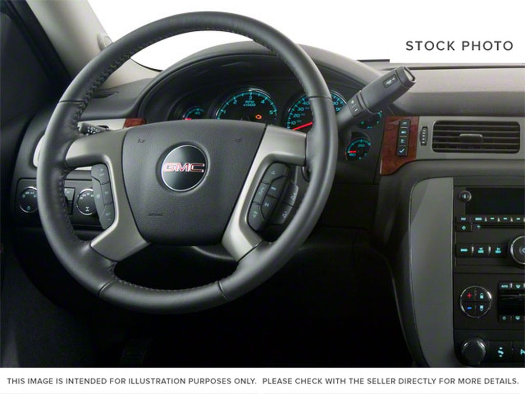 Grey 2011 GMC Yukon Steering Wheel and Dash Photo in Medicine Hat AB