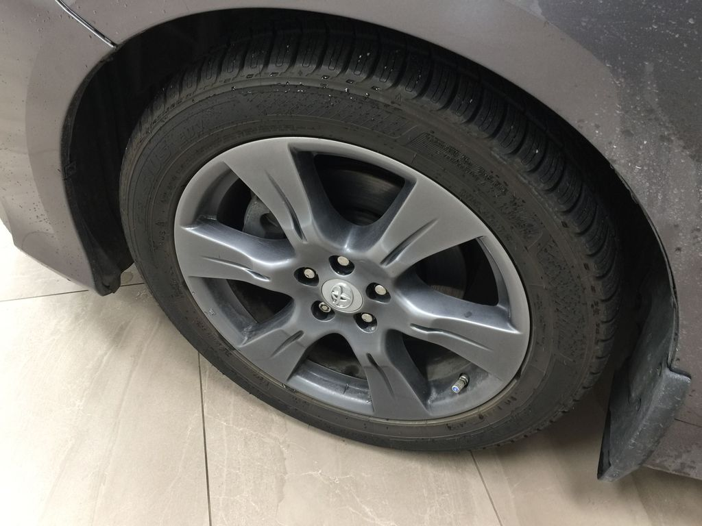 Gray[Pre-Dawn Grey Mica] 2017 Toyota Sienna SE Left Front Rim and Tire Photo in Sherwood Park AB