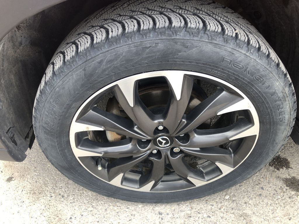 Red[Soul Red Mica] 2016 Mazda CX-5 Left Front Rim and Tire Photo in Canmore AB