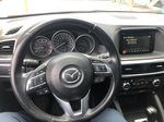 Red[Soul Red Mica] 2016 Mazda CX-5 Steering Wheel and Dash Photo in Canmore AB