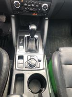 Red[Soul Red Mica] 2016 Mazda CX-5 Center Console Photo in Canmore AB