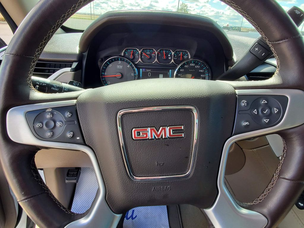White[Summit White] 2017 GMC Yukon Left Front Head Light / Bumper and Grill in Fort Macleod AB