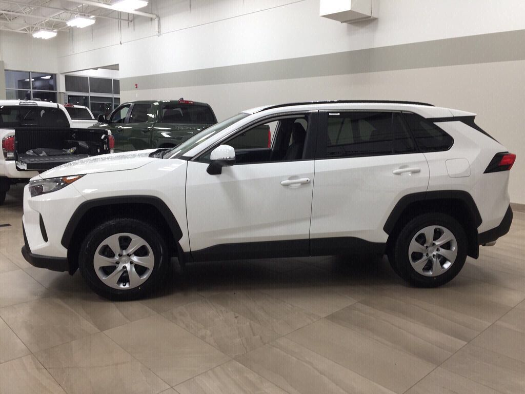 White[Super White] 2021 Toyota RAV4 LE AWD Left Side Photo in Sherwood Park AB
