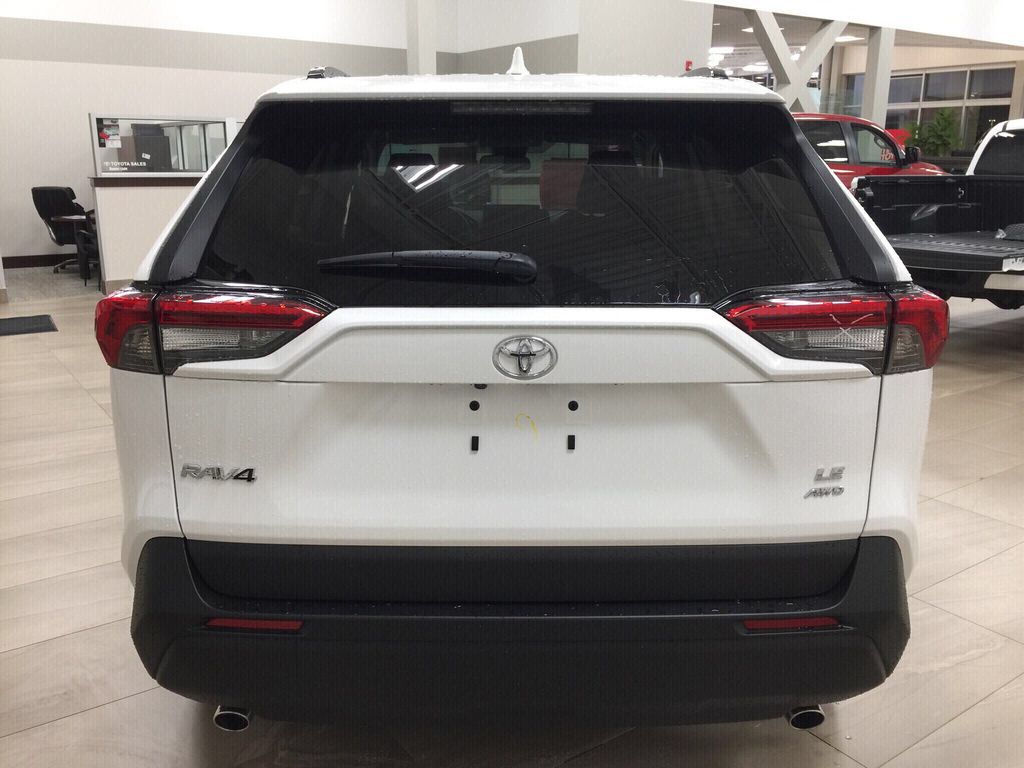 White[Super White] 2021 Toyota RAV4 LE AWD Rear of Vehicle Photo in Sherwood Park AB