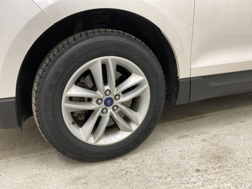 White[Oxford White] 2017 Ford Edge Left Front Rim and Tire Photo in Dartmouth NS