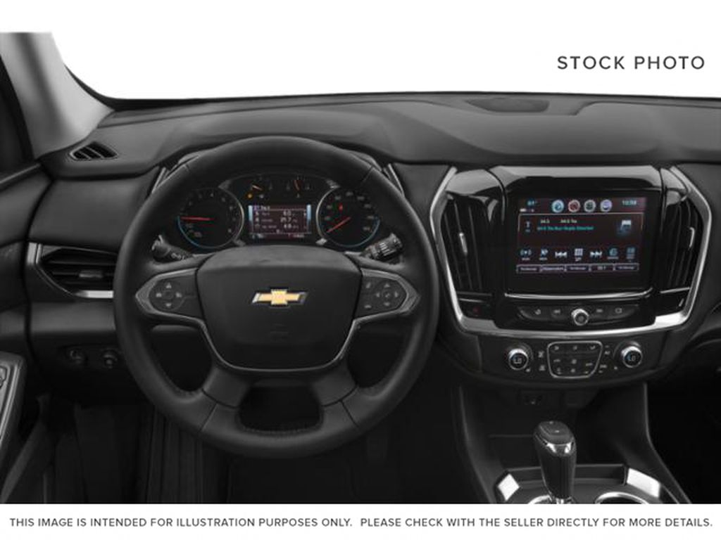 Black[Mosaic Black Metallic] 2020 Chevrolet Traverse Steering Wheel and Dash Photo in Fort Macleod AB