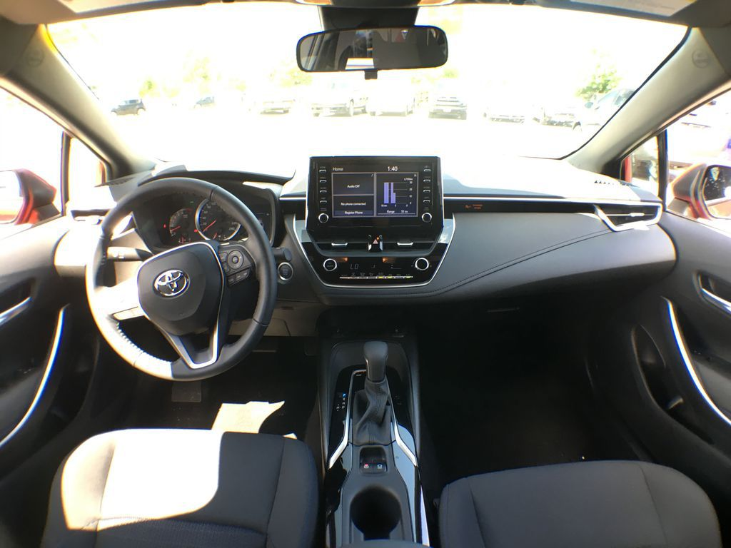 Red[Barcelona Red Metallic] 2021 Toyota Corolla SE Standard Package B4RBSC AM Center Console Photo in Brampton ON