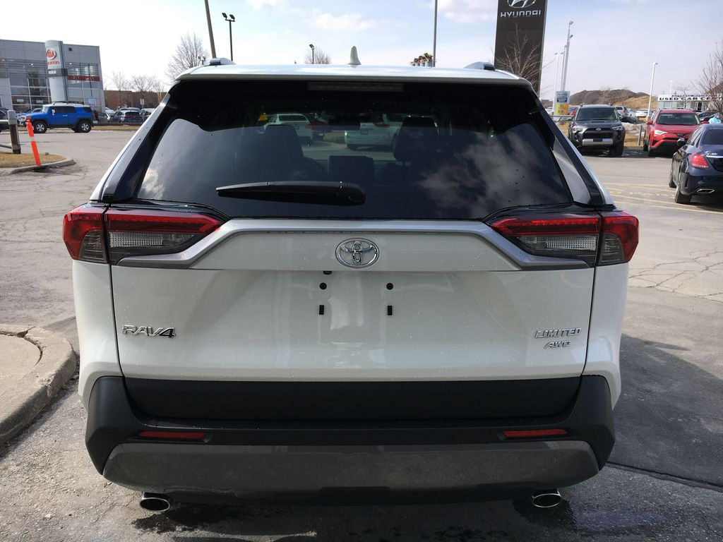 White[Blizzard Pearl] 2021 Toyota RAV4 AWD Limited Package D1RFVT AB Strng Wheel/Dash Photo: Frm Rear in Brampton ON
