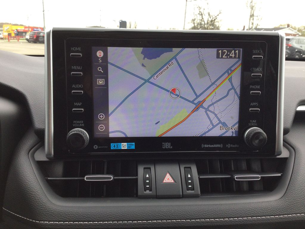 Red[Ruby Flare Pearl] 2021 Toyota RAV4 Navigation Screen Closeup Photo in Brockville ON