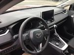 Red[Ruby Flare Pearl] 2021 Toyota RAV4 Steering Wheel and Dash Photo in Brockville ON