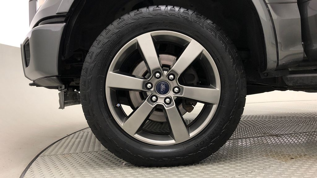 Silver[Ingot Silver Metallic] 2016 Ford F-150 XLT Sport Package 4WD - 20in Wheels, SuperCrew Left Front Rim and Tire Photo in Winnipeg MB