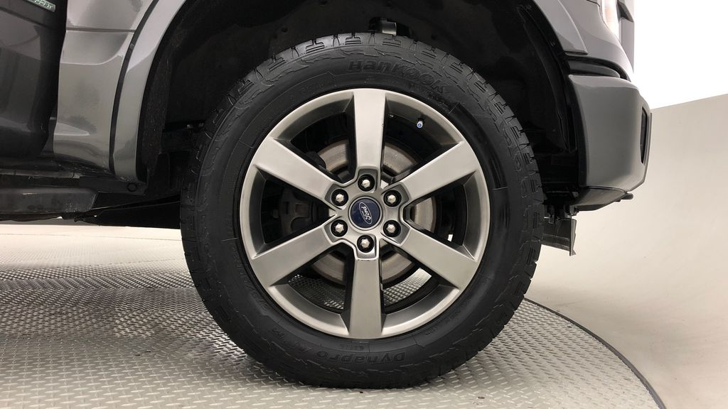 Silver[Ingot Silver Metallic] 2016 Ford F-150 XLT Sport Package 4WD - 20in Wheels, SuperCrew Right Front Rim and Tire Photo in Winnipeg MB