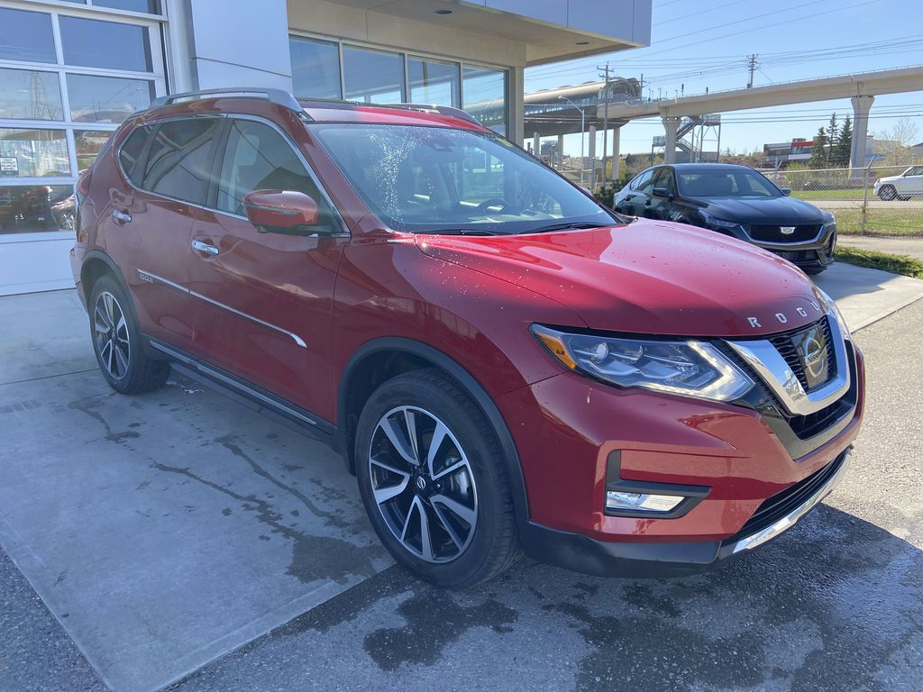 Red[Palatial Ruby Metallic] 2017 Nissan Rogue SL AWD Right Front Corner Photo in Calgary AB