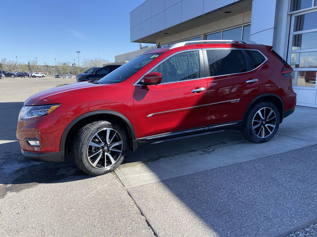 Red[Palatial Ruby Metallic] 2017 Nissan Rogue SL AWD Left Front Corner Photo in Calgary AB