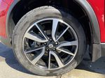 Red[Palatial Ruby Metallic] 2017 Nissan Rogue SL AWD Left Front Rim and Tire Photo in Calgary AB