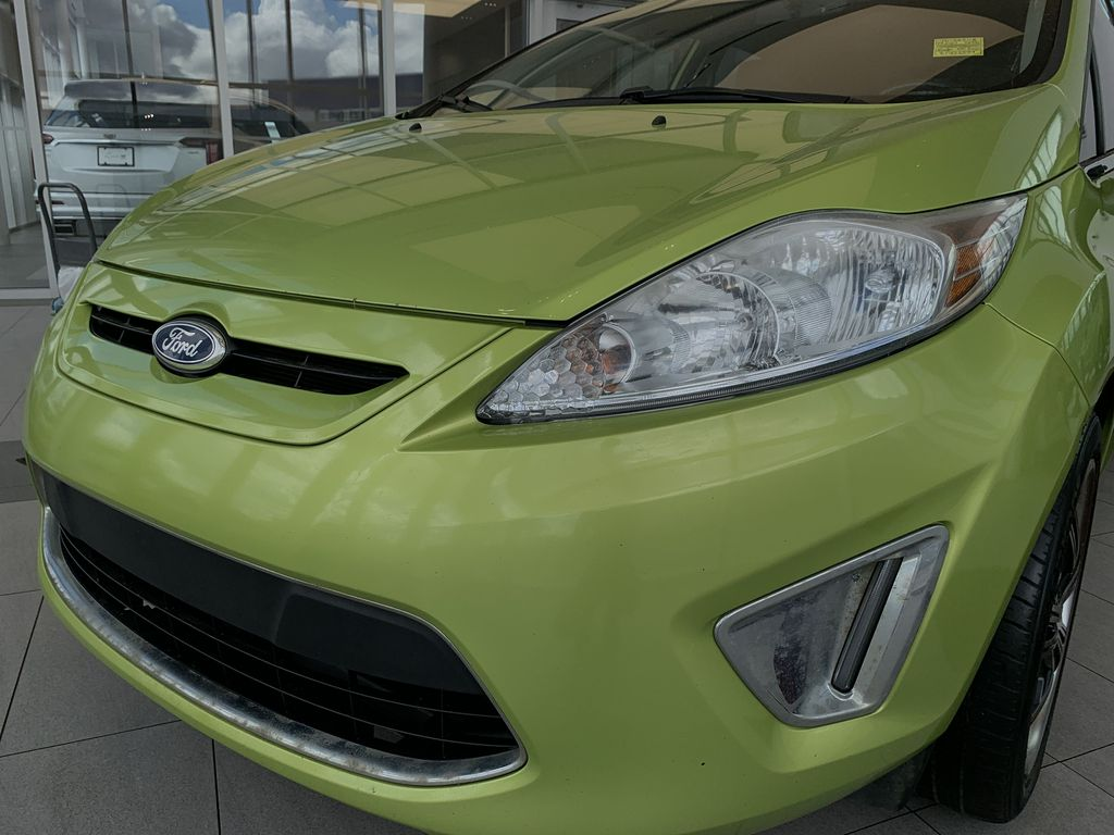 Green[Lime Squeeze Metallic] 2011 Ford Fiesta Left Front Head Light / Bumper and Grill in Edmonton AB