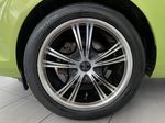 Green[Lime Squeeze Metallic] 2011 Ford Fiesta Left Front Rim and Tire Photo in Edmonton AB