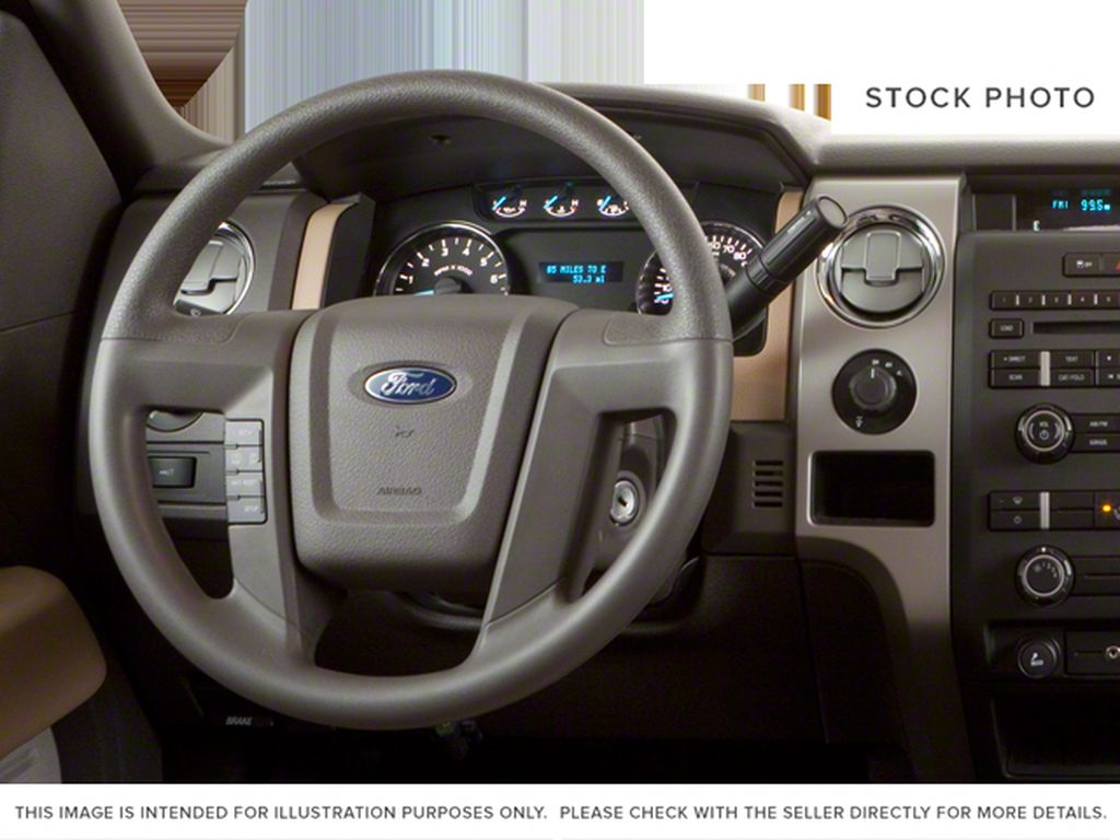 Blue[Blue Flame Metallic] 2012 Ford F-150 Steering Wheel and Dash Photo in Fort Macleod AB