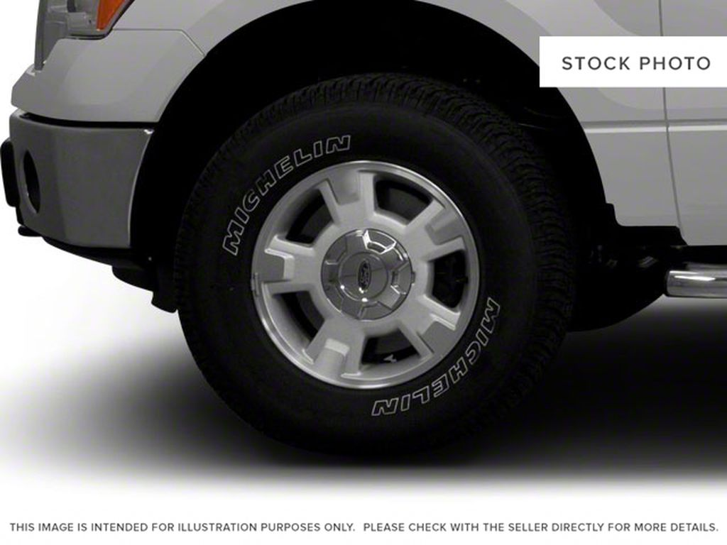Blue[Blue Flame Metallic] 2012 Ford F-150 Left Front Rim and Tire Photo in Fort Macleod AB