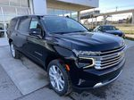 Black[Black] 2021 Chevrolet Suburban High Country Right Front Corner Photo in Calgary AB
