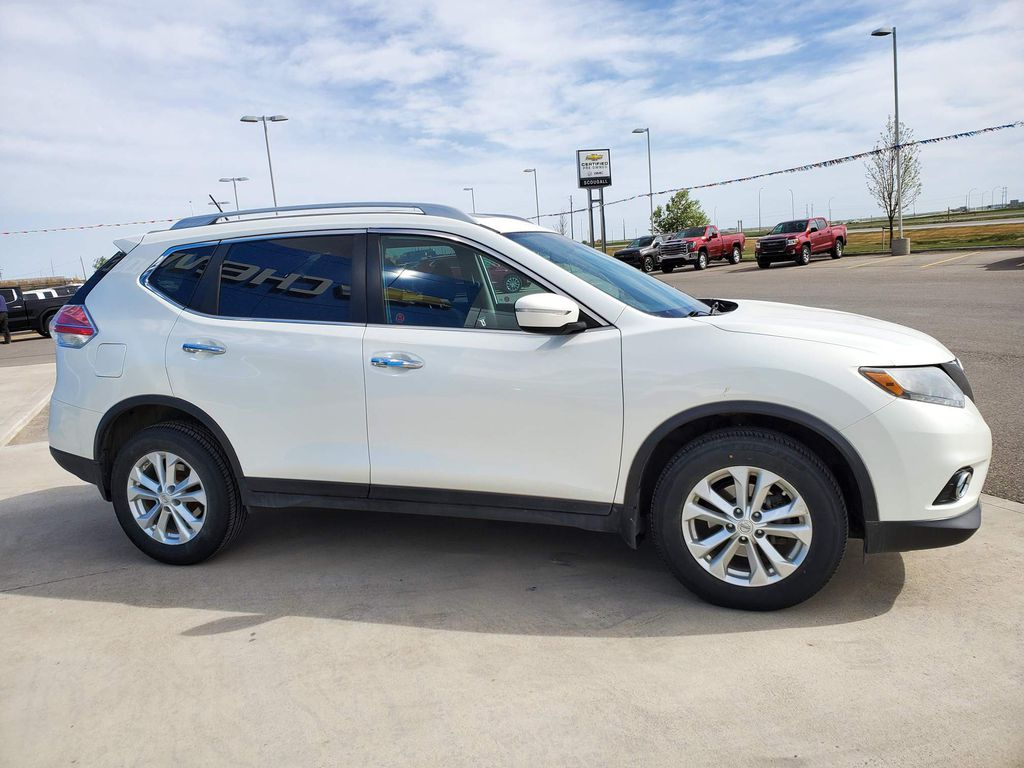 White[Moonlight White Pearl] 2014 Nissan Rogue Left Front Interior Door Panel Photo in Fort Macleod AB