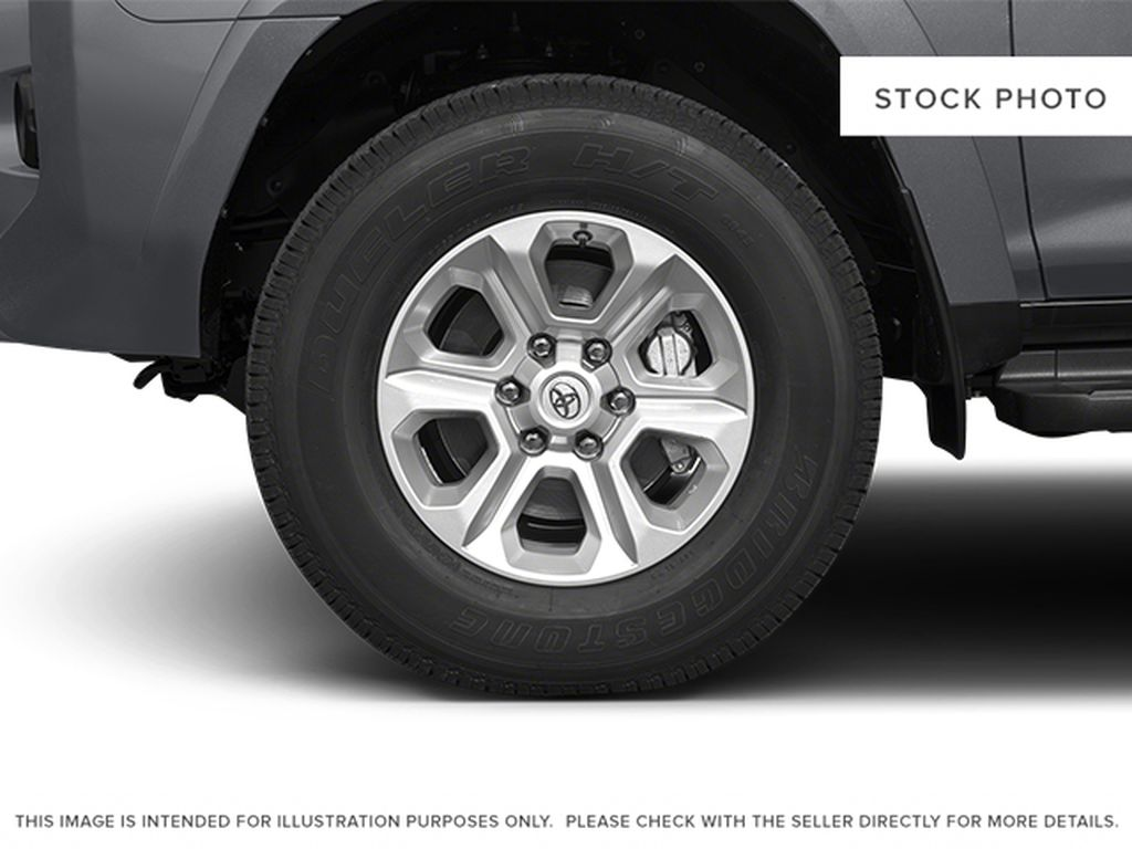 Red[Barcelona Red Metallic] 2014 Toyota 4Runner Left Front Rim and Tire Photo in Fort Macleod AB
