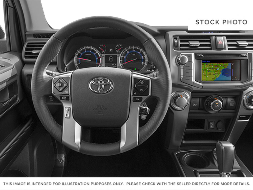 Red[Barcelona Red Metallic] 2014 Toyota 4Runner Steering Wheel and Dash Photo in Fort Macleod AB