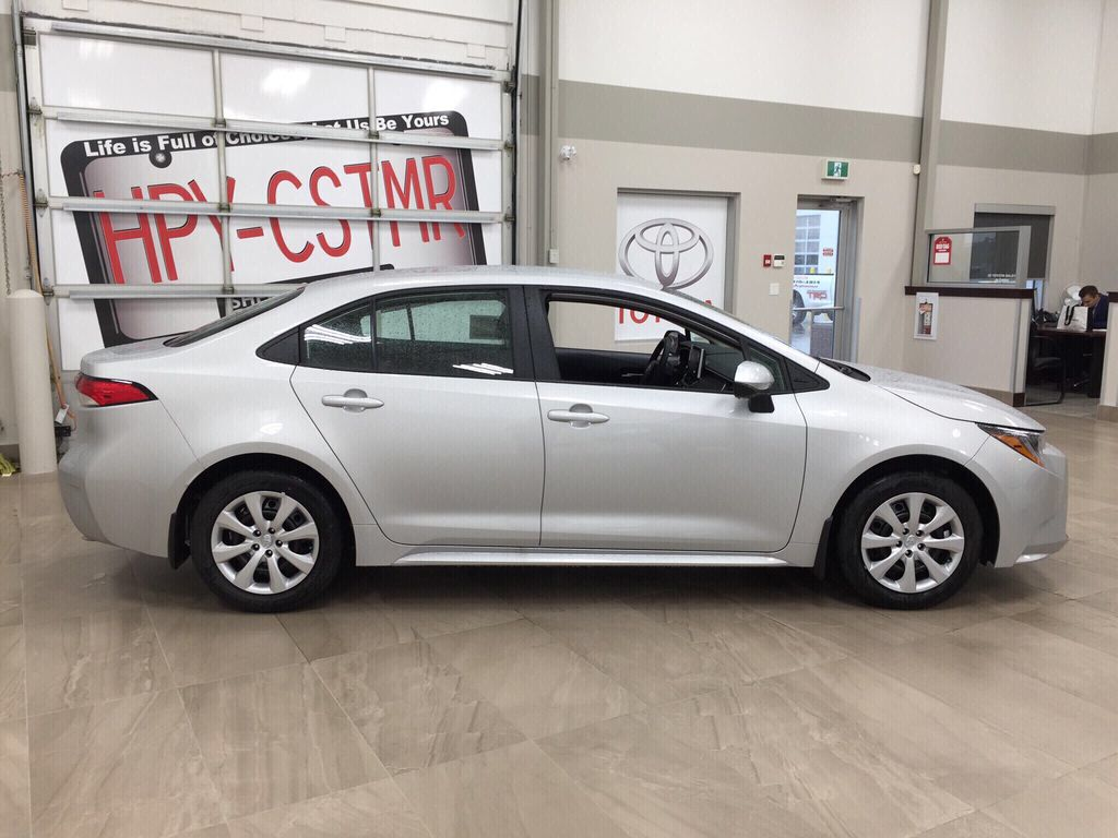 Silver[Classic Silver Metallic] 2021 Toyota Corolla LE Right Side Photo in Sherwood Park AB