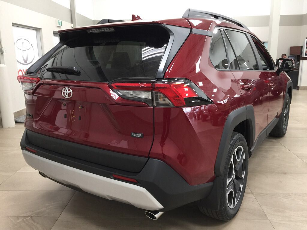 Red[Ruby Flare Pearl] 2021 Toyota RAV4 Trail Right Rear Corner Photo in Sherwood Park AB