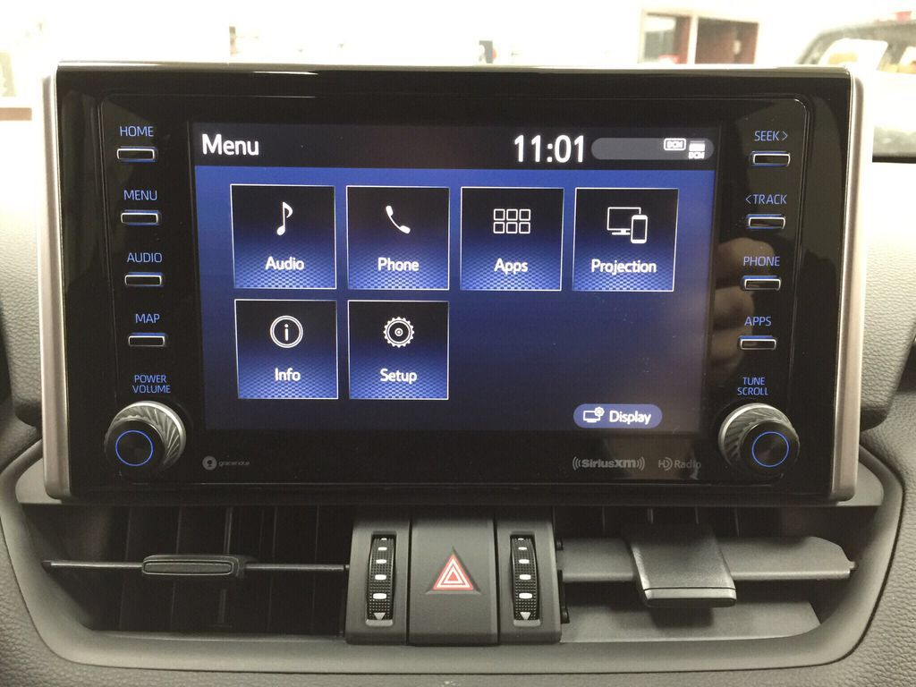 Red[Ruby Flare Pearl] 2021 Toyota RAV4 Trail Infotainment Closeup Photo in Sherwood Park AB
