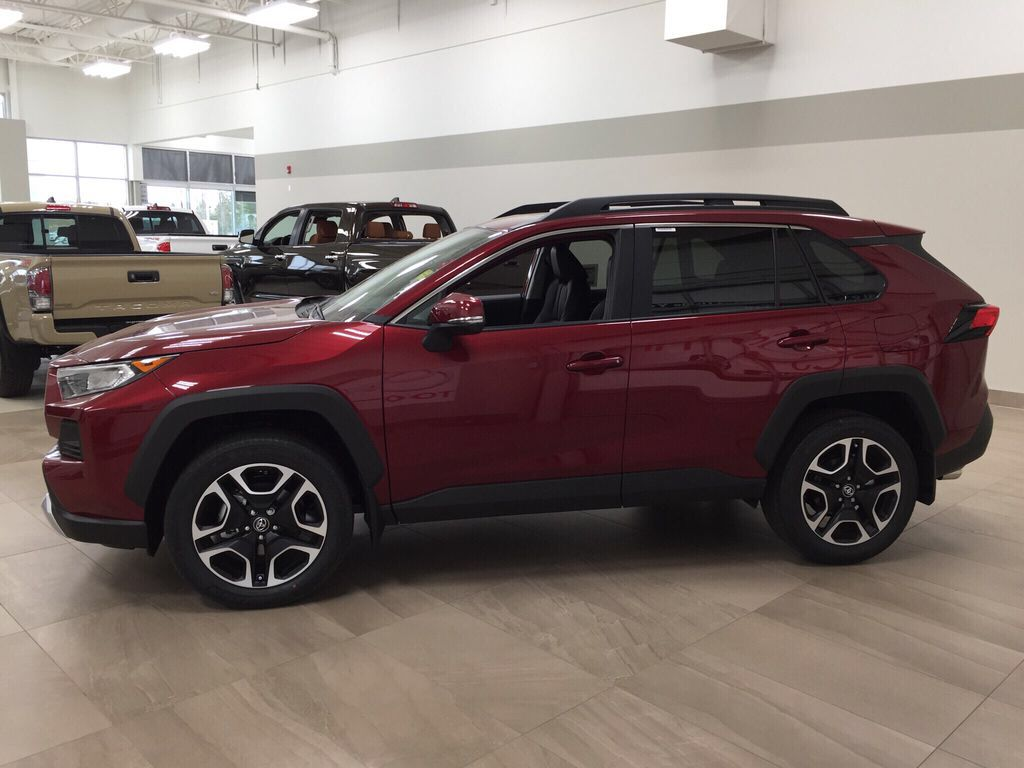 Red[Ruby Flare Pearl] 2021 Toyota RAV4 Trail Left Side Photo in Sherwood Park AB