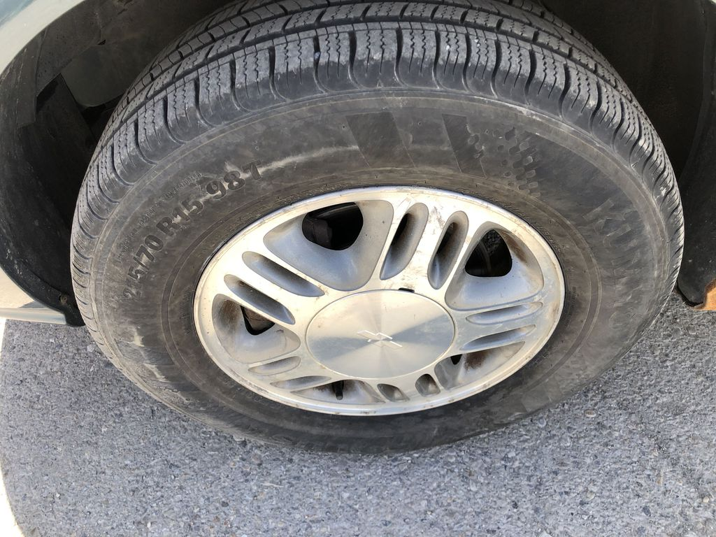 Blue[Blue Granite Metallic] 2005 Chevrolet Venture Left Front Rim and Tire Photo in Canmore AB