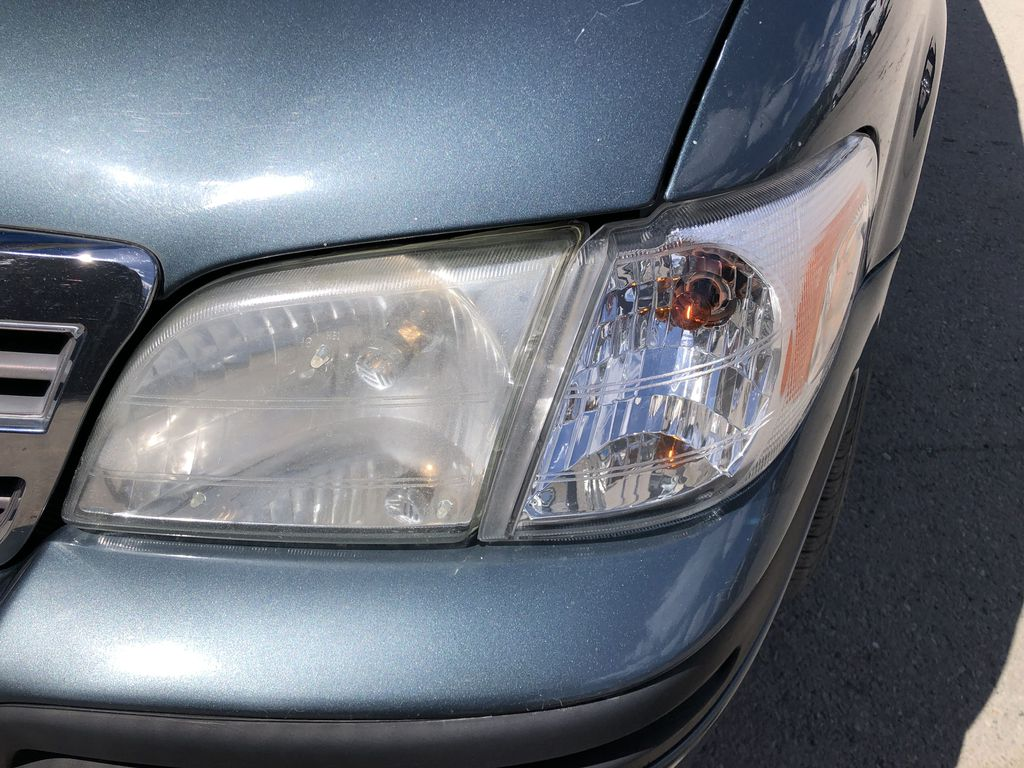 Blue[Blue Granite Metallic] 2005 Chevrolet Venture Left Front Head Light / Bumper and Grill in Canmore AB