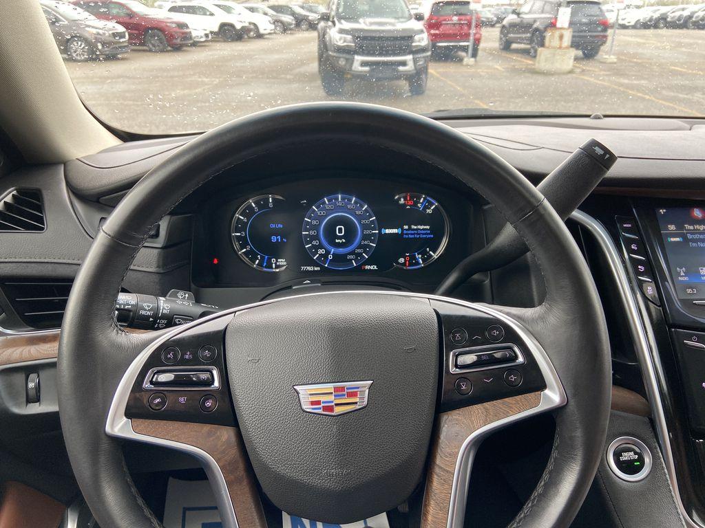 White[Crystal White Tricoat] 2019 Cadillac Escalade ESV Steering Wheel and Dash Photo in Calgary AB