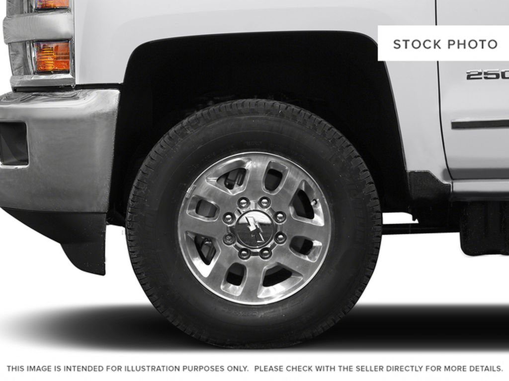 White[Summit White] 2015 Chevrolet Silverado 2500HD Built After Aug 14 Left Front Rim and Tire Photo in Fort Macleod AB