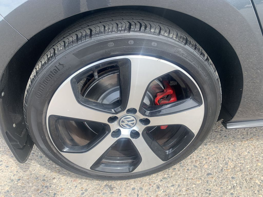 Gray[Carbon Steel Metallic] 2015 Volkswagen Golf GTI 5dr HB Man Performance *210HP!* *Turbocharged* Left Front Rim and Tire Photo in Brandon MB