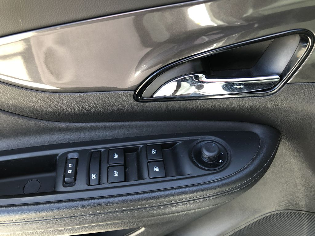 White[Summit White] 2017 Buick Encore CX  Driver's Side Door Controls Photo in Canmore AB