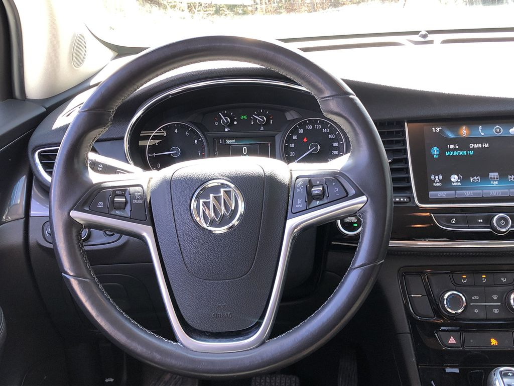 White[Summit White] 2017 Buick Encore CX Strng Wheel: Frm Rear in Canmore AB