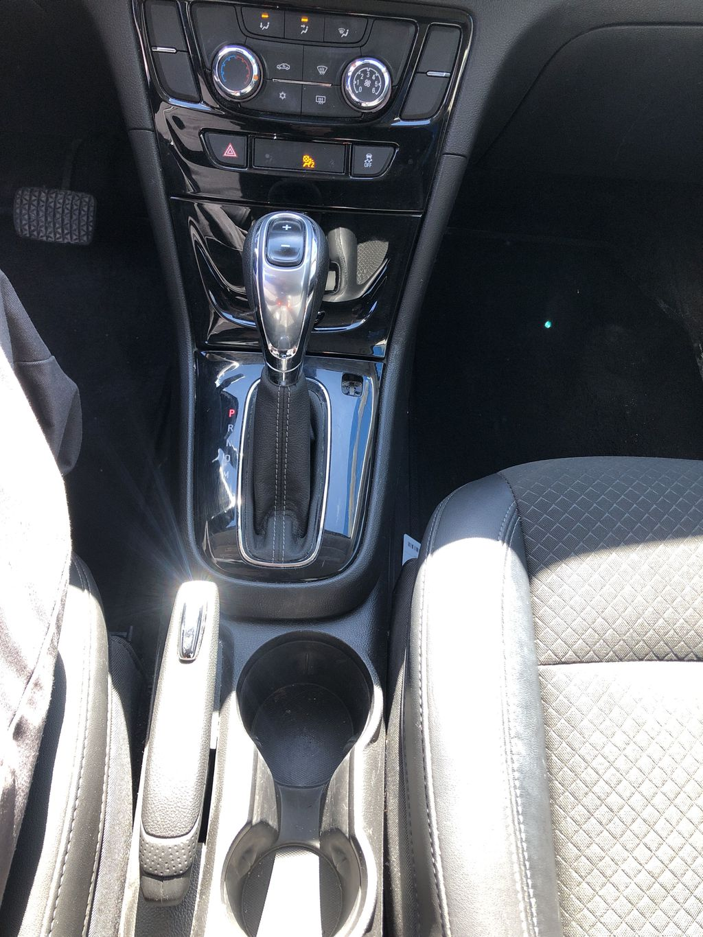 White[Summit White] 2017 Buick Encore CX Center Console Photo in Canmore AB
